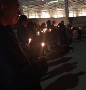 Read more about the article From the Streets to the Grave holds candle lit vigil